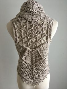 Unique, one of a kind vest with the Flower of Life design at the back. Beautiful and delicate stitch with picot border. Made with a Peruvian cotton and acrylic blend of a neutral pebble color. Size: Small / Medium Fits bust measurements of 33inches to 36 inches. Adjustable with the