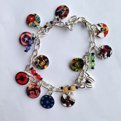 This bracelet features 10 charms that include characters/symbols such as:  Iron Man, Captain America, Thor, Hulk, Deadpool, Wolverine, Colossus, Nightcrawler, Banshee, Storm, and Spiderman.  I have strung through the links one of my illusion beaded corders so you will have pops of color through o...
