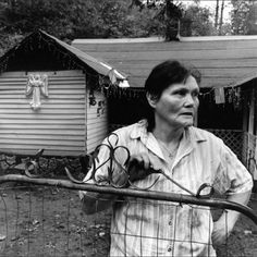 This picture reminds me so much of my husband's aunt Betty. The gate at her house is to keep the chickens from wandering too far.