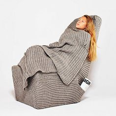 """OH MY. A crocheted sweater chair wrap <3 By interior design student from Australia: """"Sweater-like elements of the chair can be used as a headrest to create a cozy environment for an evening reading as well as a soft cover for chilly winter nights."""" Yes, please."""