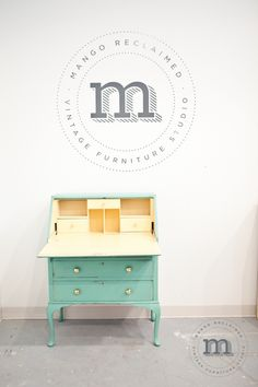 Beautiful restyled secretary desk in soft green and yellow for a baby's room. www.mangoreclaimed.com