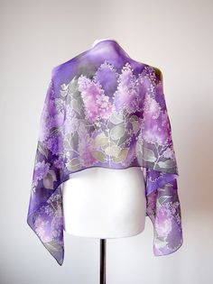 Purple silk scarf LILAC is a gorgeous hand painted scarves, decorated with lilac flowers and leaves. Delicate and romantic, you can almost catch the scent of these beautiful flowers on this violet scarf. A real eye-catcher, it's the perfect addition to any clothing ensemble - from a polished, professional look to a more casual and whimsical one.  This lilac scarves is made to order and I will need 7 - 10 days to paint it!. I painted the scarf with similar colors and patterns as those shown…