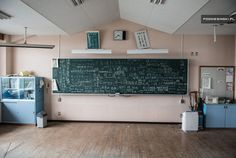 Fukushima - One of the classrooms on the first floor in the school. There is still a mark below the blackboard showing the level of the tsunami wave. On the blackboard in the classroom are words written by former residents, schoolchildren and workers in an attempt to keep up the morale of all of the victims, such as / we will be reborn / we can do it, Fukushima! / stupid TEPCO / we were rivals in softball, but always united in our hearts! / We will definitely be back! / etc