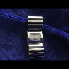 Watch------ Free with purchase Cute wide band bracelet watch. Silver and black Accessories Watches
