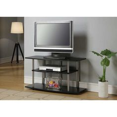 """Home Furniture Small Space Furniture Living RoomGet the Designs 2 Go TV Stand, for TVs up to 42"""" by Convenience Concepts to place your wide-screen LCD or LED TV. The three tier TV stand offers a large space to organize all audio and video accessories in one place. Designed in a modern style, the wide-screen TV stand suits your living room decor. You can also use the shelves in the 42 inch TV stand for displaying photos, decorative items, books, and other stuff. Manufactured with sturdy l..."""