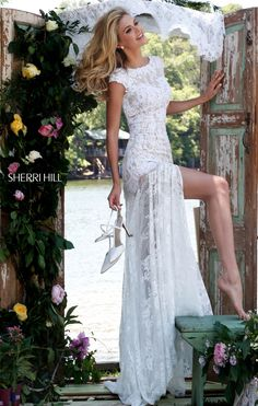 Sherri Hill  But the back is so low
