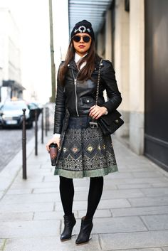 A moto jacket and a beanie toughened up an ornate, girlie skirt.