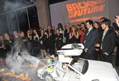 Charm City Cakes   Delorean Cake - Back to the Future inspired carved cake is the Delorean time machine complete with smoking thrusters and firey tire marks. Cake was made in honor of and presented at the 25th anniversary of the classic film trilogy.