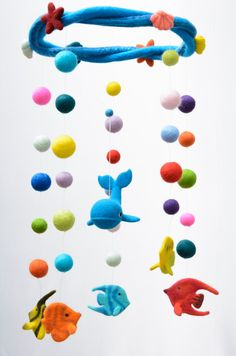 Hello and welcome to Rêves de Laine! This felt mobile is 100% handmade. Each toy is lovingly created from soft merino wool using needle-felting technics. It is custom made at the time of sale and can vary slightly from the pictured one. The baby mobile includes: - 1 whale (9 x 7.5 x 5 cm -- 3.5 x 3 x 2 in) - 5 tropical fishes (about 7 x 5 x 2 cm -- 2.5 x 2 x 1 in) - painted with pastel - 2 sea stars (4 cm -- 1.5 in) - 4 different shells (3 cm --1 in) - 28 multicolor balls (from 1 to 3 cm…