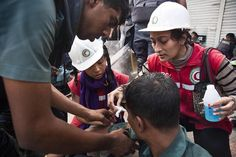 On assignment photo... The volunteers of Red Crescent Youth (RCY) are giving first aid treatment to an injured police during the clashes of nationwide blockade in Chittagong. At least 35 people including law enforcers civilians and pedestrians got first aid who got injured in clashes following the blockade. The nationwide blockade was called by Bangladesh Nationalist Party (BNP) to protest the declaration of general election. On 25th November the CEC announced that Bangladesh will go to…