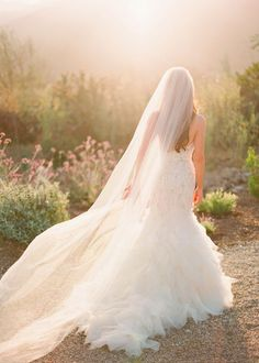 A stunning long veil!  Wedding Inspiration  by Micheal and Anna Costa