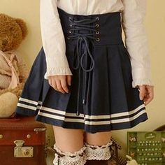This is so cute, but I would definitely wear it a bit longer - Lace-Up Pleated Skirt