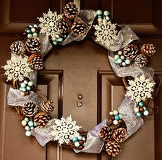 Photos of the most beautiful pinecone wreaths beautiful wreath with glittered ribbon, pinecones, berries and . Pine Cone Crafts, Wreath Crafts, Diy Wreath, Holiday Crafts, Wreath Ideas, Snowflake Wreath, Snowflakes, Door Wreaths, Ribbon Wreaths