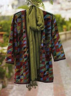 Kaffe Fassett's Origami Kimono for Peruvian Connection.  He uses this pattern on pillows, afghans and vests as well.