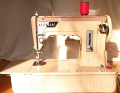 This is a Japanese Featherweight sewing machine.  This Belvedere has the same lift-up bed extension as the Singer Featherweight, for small footprint storage.