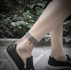 Beautiful ornamental anklet tattoo