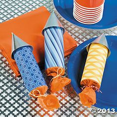 Rocket Party Favors wrap craft roll in coordinating paper, and tissue paper. Fill with candy. Tie with string.