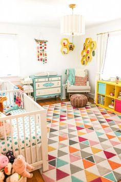Parabo Prints | A Bright and Colorful Boy/Girl Twin Nursery by The Salty Canary. #kidsBedroom