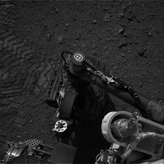 Curiosity Rover Makes First Tracks on Mars