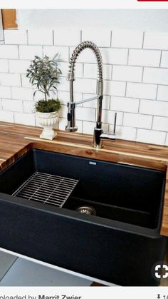 Black farmhouse sink.