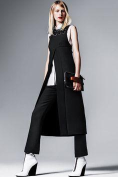 Prada dress, $2,950, and pants, $1,070, prada.com. Calvin Klein Collection shirt, $395, 212-292-9000. Clutch, $945, Balenciaga by Nicolas Ghesquière. Boots, $1,250, Céline.