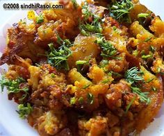 Gobi Patata or Sindhi Gobi Aloo cooked in garlic and coriander leaves sauce