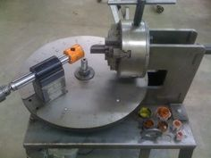 Degree Wheel Tube Notcher - Homemade tube notcher featuring a degree wheel base and utilizing a lathe chuck to secure the workpiece.