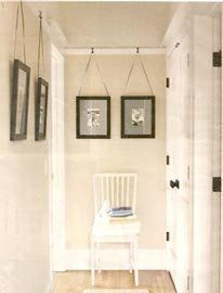use large, flat s-hooks and extra strong fishing line to hang artwork from a picture rail.