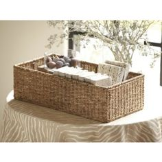 "For hiding clutter or projects ""in plain sight"" on a bookshelf  Small Woven Basket 