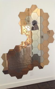 IKEA hack : Honeycomb mirror design made from multiple sets of IKEA hex mirrors | http://www.houzz.com/photos/15392427/Honeycomb-mirror-Beehive-wall-sconce-light-Decorate-with-personality-modern-hall-dallas