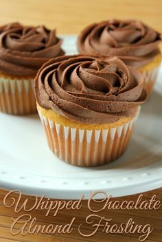 This Whipped Chocolate Almond Frosting is light, airy, and perfect for yellow cupcakes. Use a Wilton 1M tip to pipe your frosting in a rosette design.