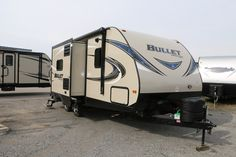 "REST AND RELAXATION ANYWHERE!!!  2017 Keystone Bullet 220RBI Work with multiple pans up top while you bake in the oven with the range in the kitchen! Stash your camp chairs and fishing poles in the pass thru storage area! The laundry chute will send the dirty clothes to the exterior storage and out of sight! You'll have no problem towing this rig at 25' 7"" long and 4,664 lbs dry.  Give our Bullet expert Mike White a call 231-903-6220 for pricing and more information."