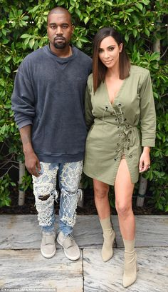 All eyes on Kim! Kim Kardashianworked her magic in a lace-up, olive green mini dress as s...