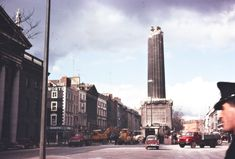 Halfway down: This picture taken on March shows Nelson's Pillar on O'Connell Street shortly after it was bombed by Irish republicans. The statue of Horatio Nelson incited anger in Ireland that an English military hero was on display there Dublin Street, Dublin City, Old Pictures, Old Photos, Irish Times, Dublin Ireland, Ireland 1916, Colour Images, Countryside