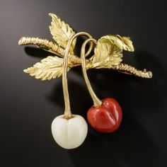 Italian cherries are sweeter and juicier, none more so than this red and white coral pair by Italy's most distinctive and collectable jeweler - Buccallati. The textured leaves and stems are hand fabricated in two-tome 18K rose and yellow gold. 1 5/8 inches. Bellissime!