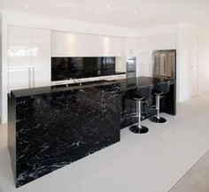 Cosmic Black Granite used for kitchen island and bench top with splash back. Fabricated and installed by Marable Slab House, Sydney.