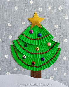 Christmas tree craft for kids made from 3 green cup cake liners, paint, and sequins. Cute and easy!