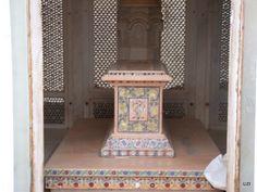 semi precious stones on the tomb of the grave in the gazebo