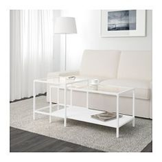IKEA - VITTSJÖ, Nesting tables, set of 2, white/glass, , The table tops in tempered glass are stain resistant and easy to clean.Stands evenly on uneven floors with the adjustable feet.Can be pushed together to save space.