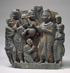 The Gift of Anathapindada, Kushan period, 2nd–3rd century Pakistan, ancient region of Gandhara Schist with traces of gold foil
