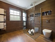 bathroom with wood floor and wall tiles