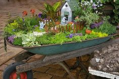 making a fairy garden in a wheelbarrow | also like this version made in an old drawer...love the rustic feel ...