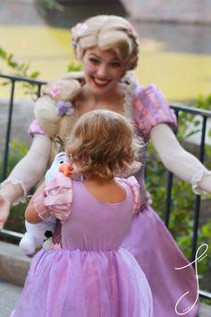 Nothing Cuter than Little Rapunzel hugging Olaf plush doll meeting Rapunzel
