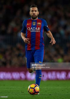 Jordi Alba of Barcelona runs with the ball during the La Liga match between FC Barcelona and Malaga CF at Camp Nou stadium on November 19, 2016 in Barcelona, Spain.