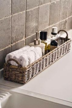 Basket for towels and toiletries near the bathtub