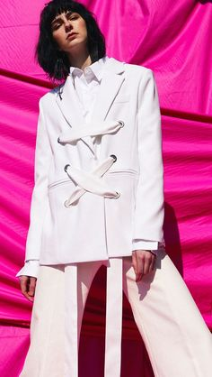 The LassoJacket in off-white. With a lapel, two flap magnetic snap tabclosures andeyelet front detailing with detachable separatesash tie. Fully lined.Rela
