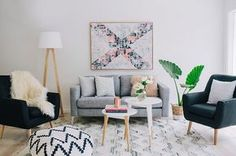 A touch of greenery for your chic Scandinavian living room [Design: Claudia Stephenson Interiors]