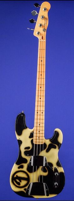1994 FENDER Tracii Guns 'Cowhide' Precision Bass, Cream with Custom Hand-Painted 'Cowhide' Design in Black. Specially Made for Tracii Guns by Larry Brooks and then Uniquely Decorated by Dan Lawrence. (via Fretted Americana)
