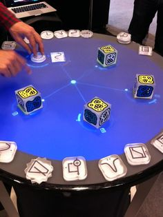 The Reactable - tangible modular synth play table ~ module symbols and their orientation are recognized by a camera above the table