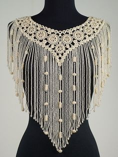 Collar; 1892l French; crocheted silk, linen and pearl beads. May have been worn under the next  acc. number which is the exact same construction, but high-necked.